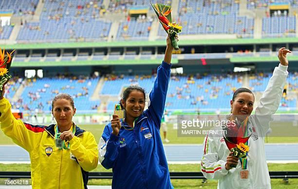 Cristina Lopez of El Salvador celebrates her 20 km walk Gold medal next to Miriam Ramon of Ecuador Silver and Maria Sanchez of Mexico Bronze during...