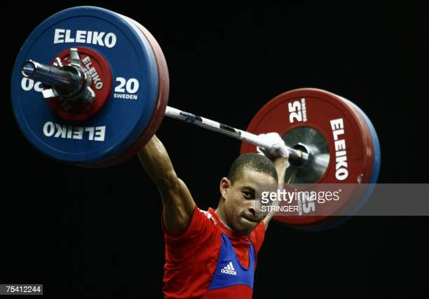 Cuba's Sergio Alvarez marks a new Pan American record lifting 120 Kg at the men's 56 Kg competition during the XV Pan American Games 2007 in Rio de...