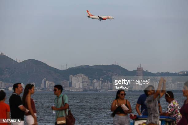 Rio de Janeiro Brazil December 19 2017 Airliner overhangs downtown Rio at low altitude to land at Santos Dumont airport