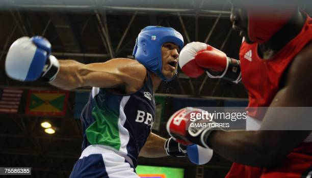 Enoch Romeo of Trinidadobago sways away from Antonio Nogueira of Brazil 21 July 2007 during the Superheavyweight preliminary round fight at the Rio...