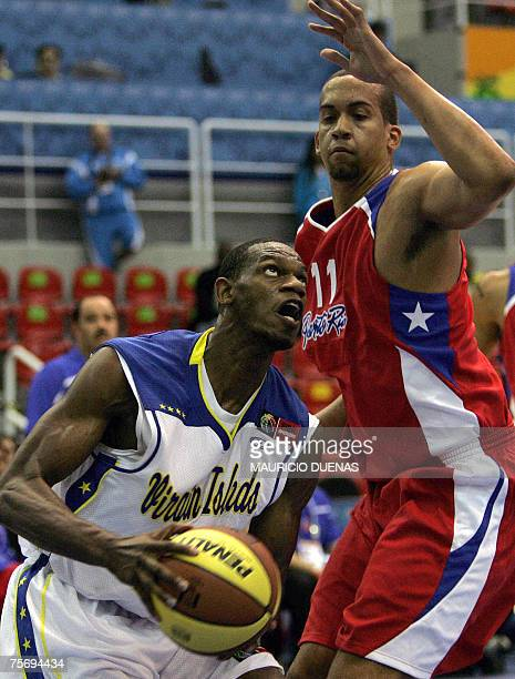 Rio de Janeiro, BRAZIL: Frank Elegar from Virgin Islands drives to the basket under the pressure of Puerto Rican Ricardo Sanchez during their XV Pan...