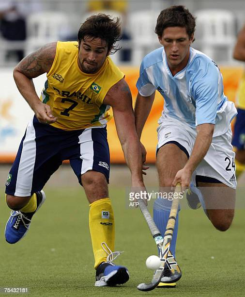 Lucas Argento of Argentina vies for the ball with Guido Hock of Brazil during their field hockey match at the XV Pan American Games Rio 2007 in Rio...