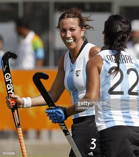 Rio de Janeiro, BRAZIL: Magdalena Aicega of Argentina celebrates with teammate Gabriela Aguirre after scoring her team's 21st goal against Brazil,...