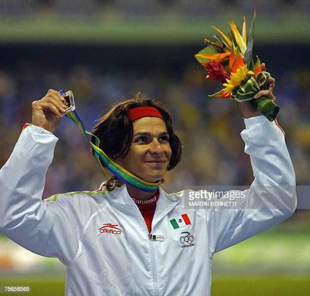 Mexican Ana Guevara celebrates a gold medal in women 400m at the XV Pan American Games 2007 in Rio de Janeiro Brazil 25 July 2007 AFP PHOTO/MARTIN...
