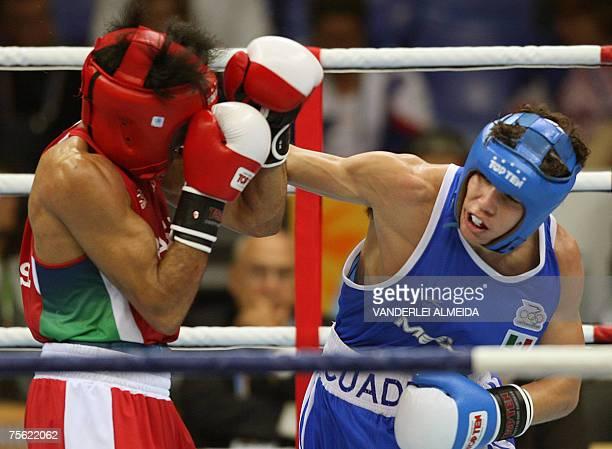 Rio de Janeiro, BRAZIL: Mexican boxer Carlos Cuadras tries to penetrate the guard of his rival Brazilian Dean Pereira during their bantamweight 54kg...