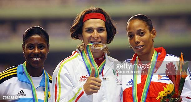Mexican gold medal winner Ana Guevara Bahamas' silver medalist Cristine Amertil and Cuba's Indira Terrero bronze winner celebrate on the podium their...