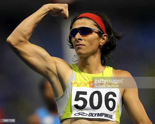 Mexican runner Ana Gabriela Guevara celebrates his gold medal for the 400m 25 July 2007 during the Pan American games in Rio de Janeiro Brazil AFP...