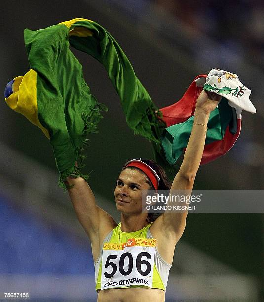 Mexican runner Ana Gabriela Guevara waves Brazil's and Mexico national flags to celebrates her 400m gold medal 25 July 2007 during the Pan American...