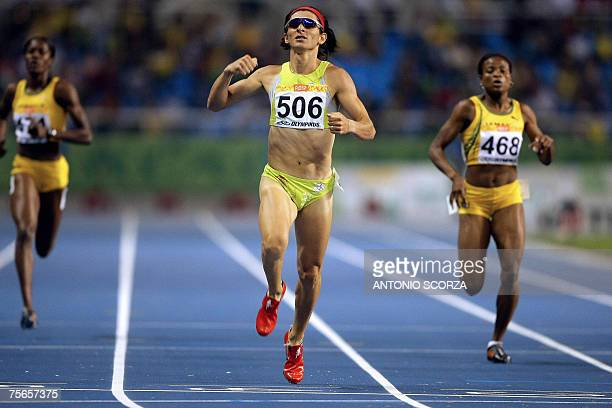 Mexican runner Ana Guevara crosses the 400m finish line to win the gold medal 25 July 2007 during the Pan American games in Rio de Janeiro Brazil AFP...