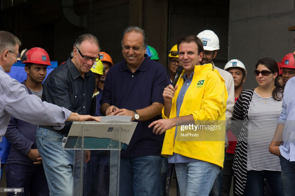Rio de Janeiro, Brazil, on October 5, 2017: President of the Brazilian Olympic Committee, Carlos Arthur Nuzman, was arrested on Thursday morning. Nuzman is suspected of brokering the purchase of votes from members of the International Olympic Committee for the election of Rio de Janeiro as the venue for the 2016 Olympics. Leonardo Gryner, former director of operations for the Rio 2016 Committee, was also arrested. In this image: Carlos Arthur Nuzman next to the Governor of Rio de Janeiro, Luiz Fernando Pezao, and the former mayor of Rio, Eduardo Paes. Photo file produced in November 8, 2015.
