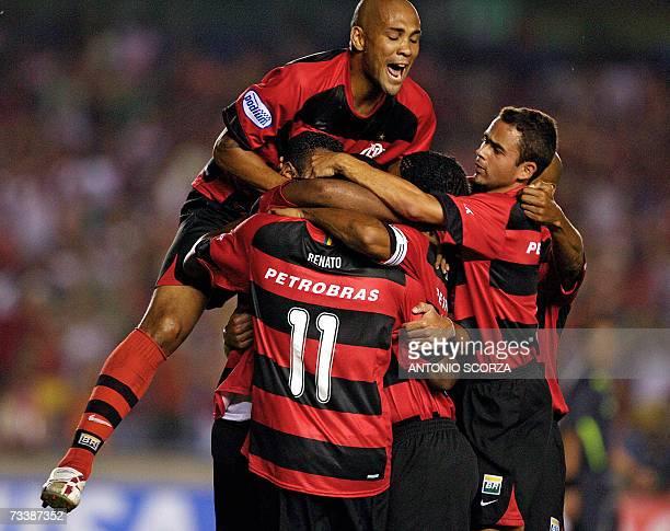Rio de Janeiro, BRAZIL: Rodrigo de Souza and Juan Jr. Jumps over teammate Carlos Alberto de Abreu of Flamengo as they celebrate scoring a goal...
