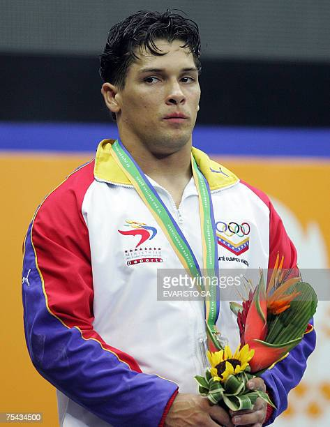 Silver medal in the men's 77 kg of the weightlifting competition Venezuelan Jose Ocando stands at the podium during the Pan American Games 16 July...
