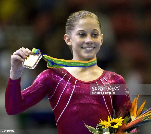 US gymnast Shawn Johnson shows her gold medal for the individual female allaround final of gymnastics during the XV Rio 2007 Pan American Games at...
