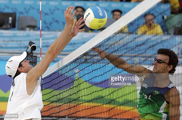 Rio de Janeiro, BRAZIL: US player Hans Stolfus tries to block Brazilian Emanuel Rego's spike during their Beach Volleyball gold medal match for the...