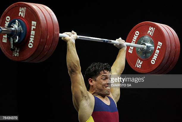 Venezuelan Jose Ocando performs during men's 77 kg of the weightlifting competition during the Pan American Games in Rio de Janeiro Brazil 16 July...