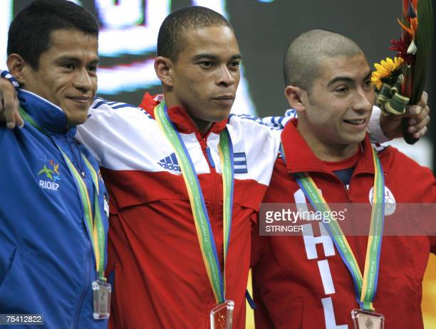 Weightlifting men 56 Kg competitors Cuban Gold medalist Sergio Alvarez Salvadorean Silver medalist Marvin Lopez and Chilean Bronze medalist Jaime...