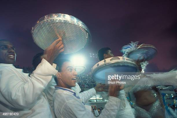 Rio de Janeiro Carnival Samba Schools Parade Brazil Carnival dancers playing percussion instrument pandeiro a type of hand frame drum popular in...