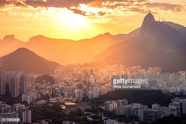 rio de janeiro city view with christ the redeemer statue at sunset - latin america stock pictures, royalty-free photos & images