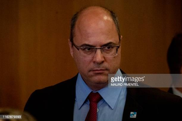Rio de Janeiro Governor Wilson Witzel arrives to give a press conference after a hijacker held a busload of passengers hostage for several hours...