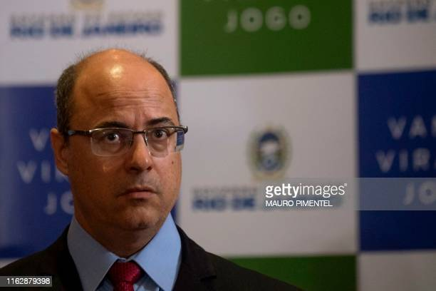 Rio de Janeiro Governor Wilson Witzel gives a press conference after a hijacker held a busload of passengers hostage for several hours before he was...