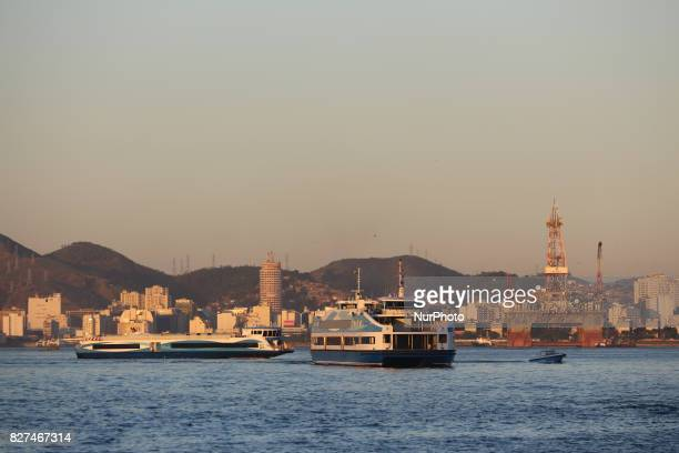 Rio de Janeiro has sunny and hot afternoon in winter In this image boats that make the crossing between Rio de Janeiro and Niterói In the background...