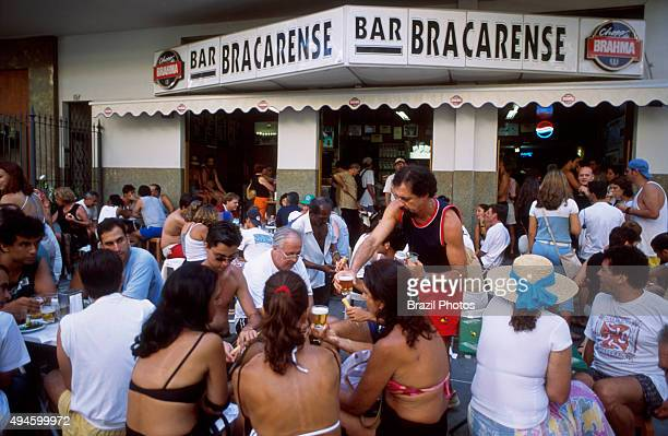 Rio de Janeiro lifestyle cariocas have fun an drink chope at the outside tables of Bracarense bar in Leblon district
