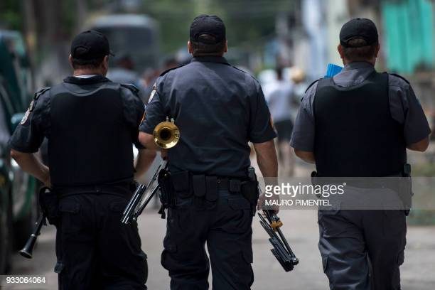 Rio de Janeiro Military Police soldiers from the Police Force Martial band leave after attending an event organized by the Brazilian Armed Forces at...