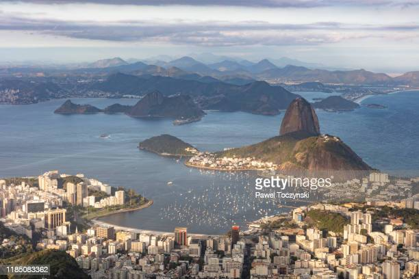 rio de janeiro seen from corcovado at sunset, brazil - botafogo brazil stock pictures, royalty-free photos & images