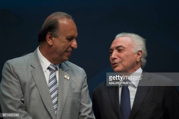 Rio de Janeiro's Governor Luiz Fernando Pezao and Brazilian President Michel Temer talk during an event announcing the beginning of the final stage...