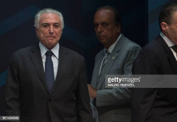 Rio de Janeiro's Governor Luiz Fernando Pezao and Brazilian President Michel Temer take part in an event to announce the beginning of the final stage...