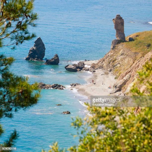 Rio de la Miel watch tower on the Alberquillas beach, part of the Cliffs of Maro-Cerro Gordo Natural Park, near Maro and Nerja, Malaga Province,...