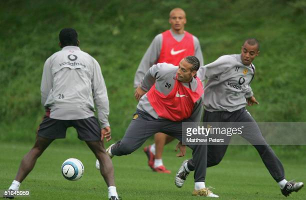 Rio Ferdinand and David Bellion of Manchester United in action during a first team training session ahead of the UEFA Champions League match against...