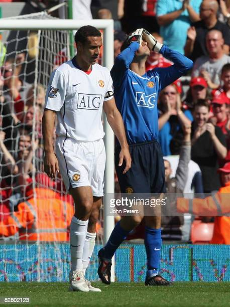 Rio Ferdinand and Edwin van der Sar of Manchester United react to Wes Brown scoring an owngoal during the FA Premier League match between Liverpool...