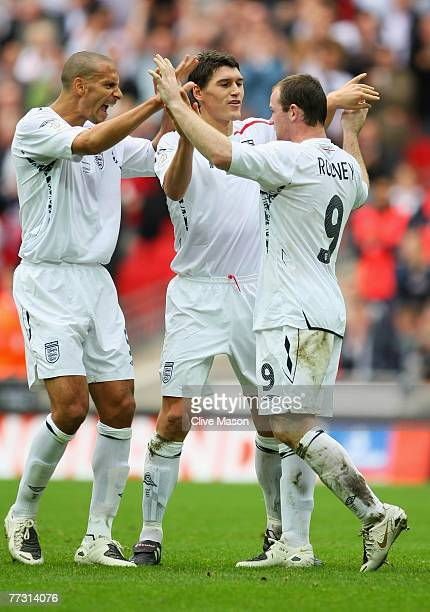 Rio Ferdinand and Gareth Barry of England celebrate with Wayne Rooney afer he scores the second goal during the Euro 2008 Group E qualifying match...
