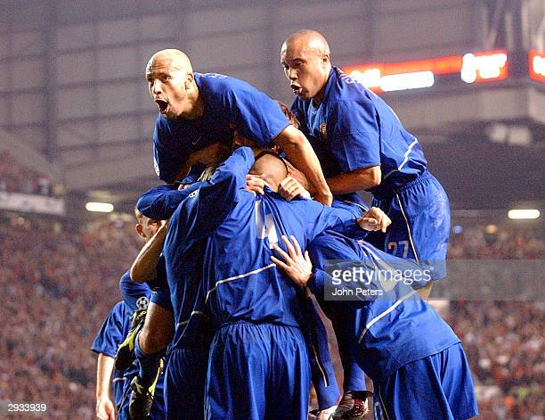 Rio Ferdinand and Mikael Silvestre celebrate with team mates after Juan Sebastian Veron scores during the UEFA Champions League match between...