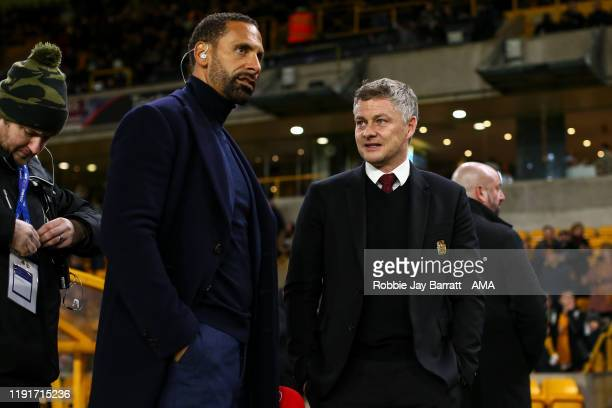 Rio Ferdinand and Ole Gunnar Solskjaer the head coach / manager of Manchester United during the FA Cup Third Round match between Wolverhampton...