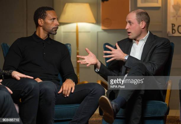 Rio Ferdinand and Prince William Duke of Cambridge speak during a visit to meet staff volunteers and supporters of 'Campaign Against Living...