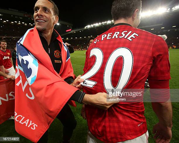 Rio Ferdinand and Robin van Persie of Manchester United celebrates on the pitch after the Barclays Premier League match between Manchester United and...