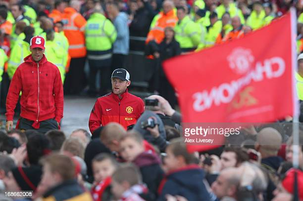 Rio Ferdinand and Wayne Rooney arrive for the Manchester United Premier League winners parade at Old Trafford on May 13 2013 in Manchester England