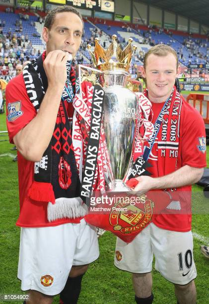 Rio Ferdinand and Wayne Rooney of Manchester United celebrate with the Premiership trophy after the Barclays FA Premier League match between Wigan...