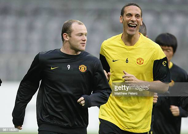 Rio Ferdinand and Wayne Rooney of Manchester United in action during a First Team Training Session ahead of their UEFA Champions League Quarter-Final...