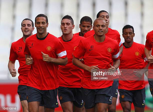 Rio Ferdinand and Wes Brown of Manchester United lead the warm up during a training session ahead of their UEFA Champions League Group C match...
