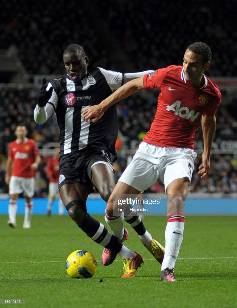 Rio Ferdinand brings down Demba Ba leading to penalty claims during the Barclays Premier League match between Newcastle United and Manchester United at The Sports Direct Arena on January 04, 2012 in Newcastle, England.