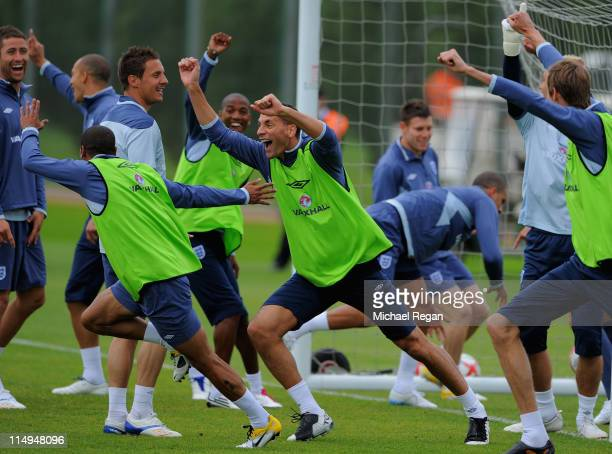 Rio Ferdinand celebrates scoring in a game of handball during the England training session at London Colney on May 31, 2011 in St Albans, England.