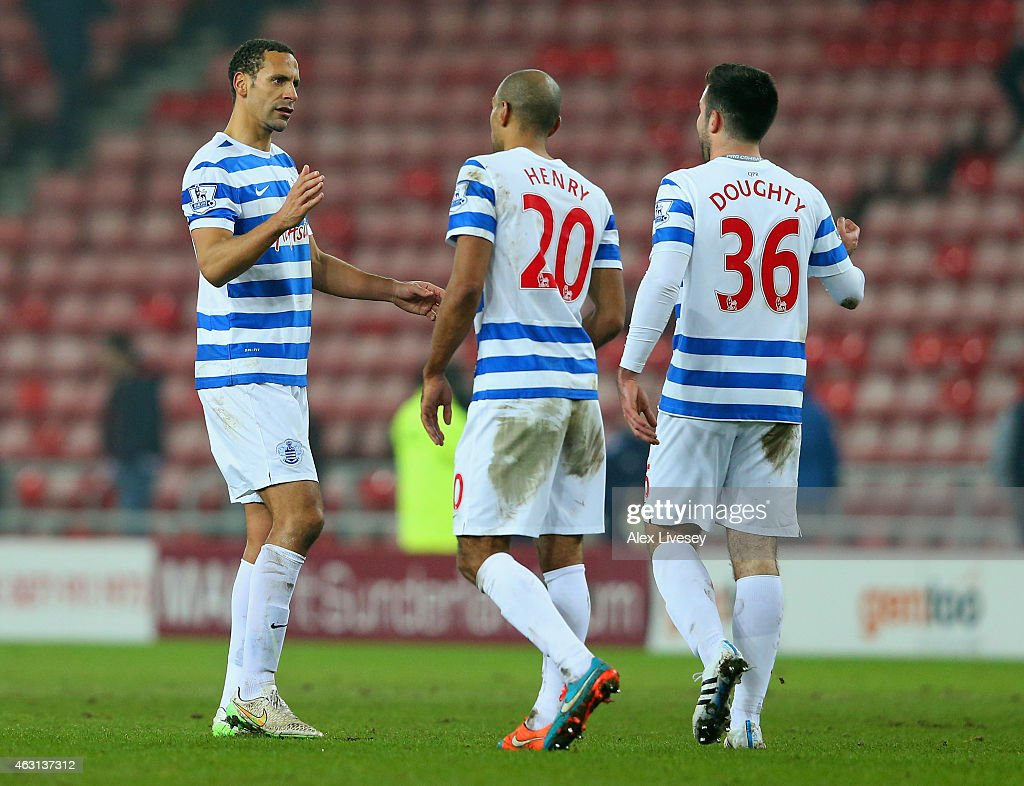 Rio Ferdinand celebrates victory with Karl Henry and Michael Doughty of QPR during the Barclays Premier League match between Sunderland and Queens Park Rangers at Stadium of Light on February 10, 2015 in Sunderland, England.