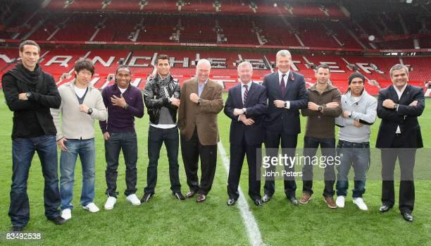 Rio Ferdinand JiSung Park Anderson Cristiano Ronaldo Sir Alex Ferguson David Gill Ryan Giggs and Carlos Tevez of Manchester United pose with...