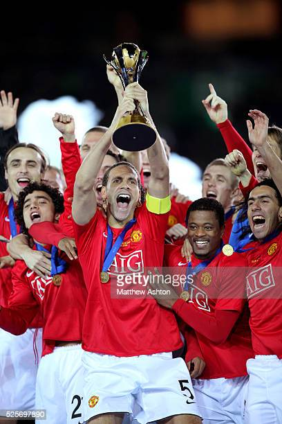 Rio Ferdinand lifts the trophy as Manchester United celebrate winning the FIFA Club World Cup 2008
