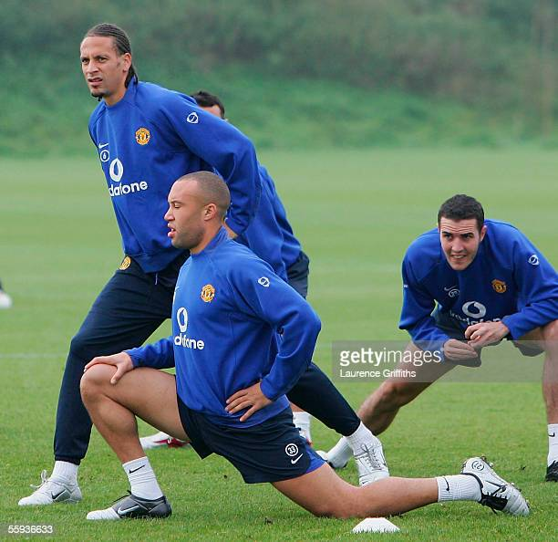 Rio Ferdinand Mikael Silvestre and John O'Shea of Manchester United warm up during training ahead of tomorrows UEFA Champions League match against...