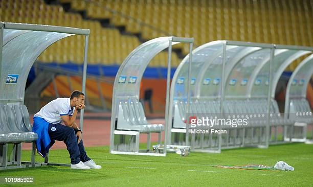 Rio Ferdinand of England looks on from the bench during the England training session at the Royal Bafokeng Stadium on June 11, 2010 in Rustenburg,...