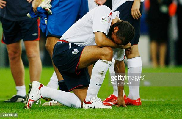 Rio Ferdinand of England shows his dejection following his team's defeat in a penalty shootout at the end of the FIFA World Cup Germany 2006...